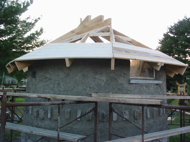 Round Cob Garden Shelter on Recycled Granite Block Foundation with Recriprocal Roof of Native Lumber